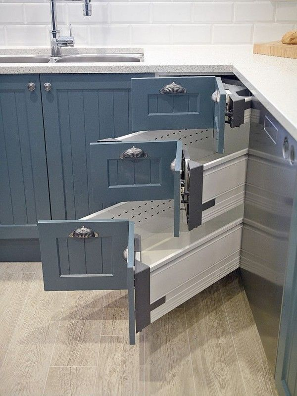 Kitchen corner drawer system from Blum with a design that matches the cabinets next to it