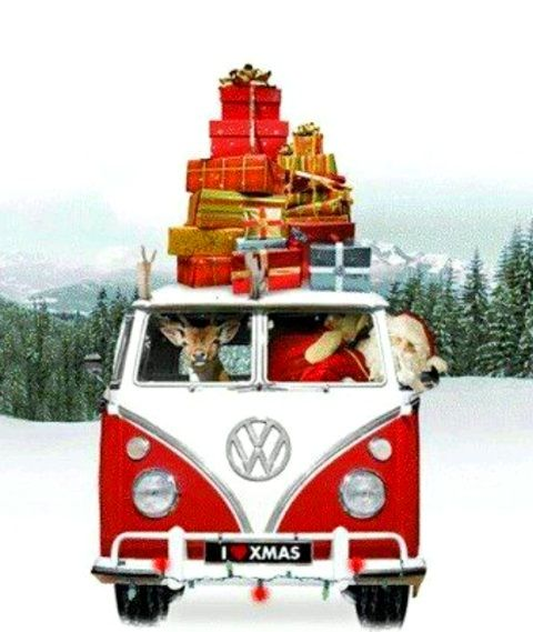Santa driving VW bus van with  laden with Christmas gifts