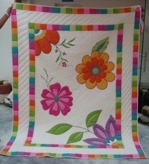 The finished quilt is for sale; no pattern. Great inspiration for an appliqued piece. Love this quilt!.