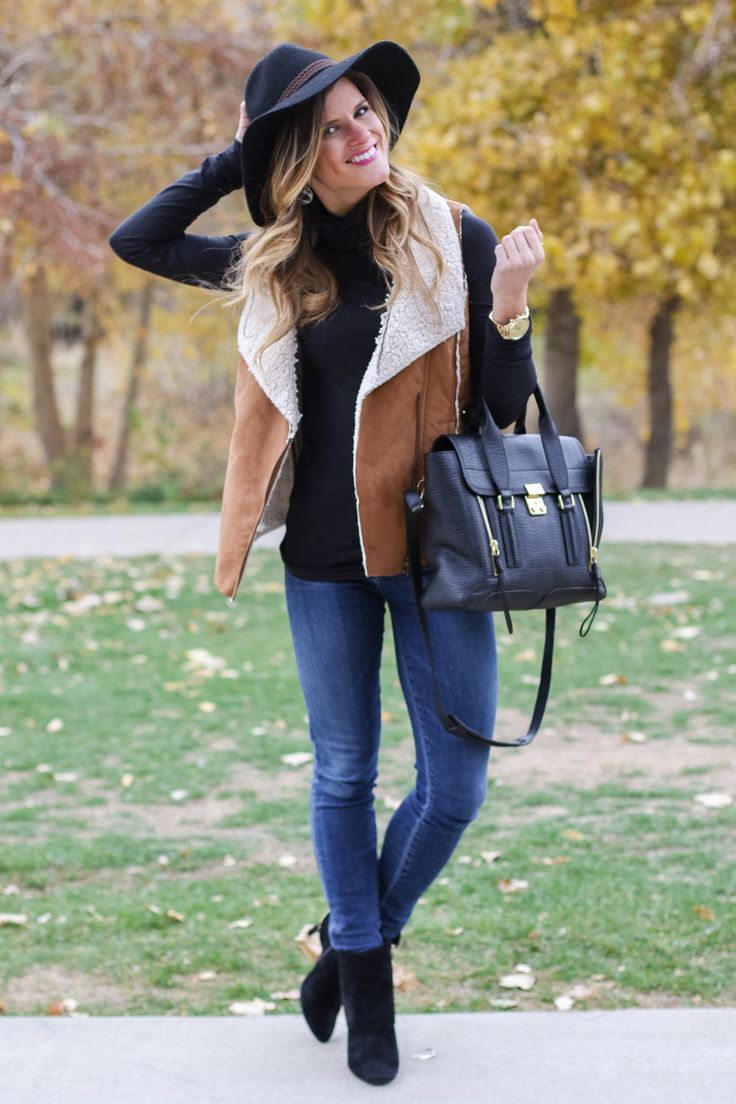 Shearling Vest Black Turtleneck Jeans Black Hat Fall Outfit