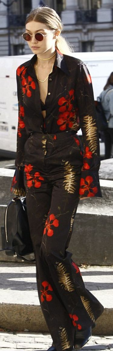 Who made Gigi Hadid's black backpack, red floral top, and pants?