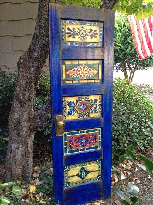 A beautifully painted door adds charm to a garden - what a fun project!