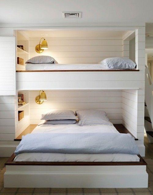 Loft bed slash bunk bed with built-in bookshelves and lighting.