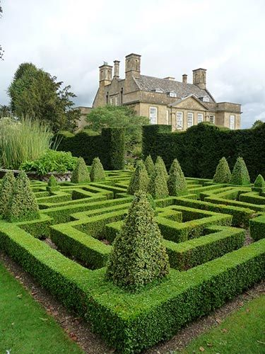 topiary at Bourton House in village of Bourton-on-the-Hill, Cotswold, UK; Jacobean house by eminent lawyer, Sir Nicholas Overbury in 1598; many owners, but last private owners 1983 by Richard & Monique Paice; sold last in 2010 as owners made Gardens public ; ) thanks to gardeners Paul Nicholls & Jacky Rae; HHA/Christie's Garden Of The Year 2006 award; 3 acre garden, 7 acre walled pasture; pictured: Knot Garden labyrinth