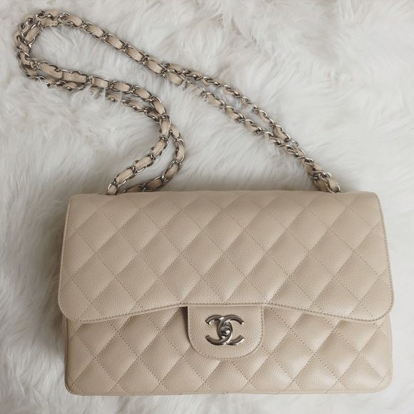 $5,500 Chanel Jumbo Flap Bag Beige Clair SHW super rare Chanel Jumbo Flap Bag in Beige Clair Caviar Leather with Silver Hardware. (double flap) jumbo is just not the right size for me. comes with box, dustbag, authenticity card, care booklet etc. holly@hollyannaeree.com for inquiries. SELLING AT RETAIL AS THIS BAG IS A SUPER RARE CLASSIC IN THE BEIGE CLAIR + THE BAG IS IN MINT CONDITION. This is for someone looking for the bag but unable to get their hands on it (not to mention you'll be…