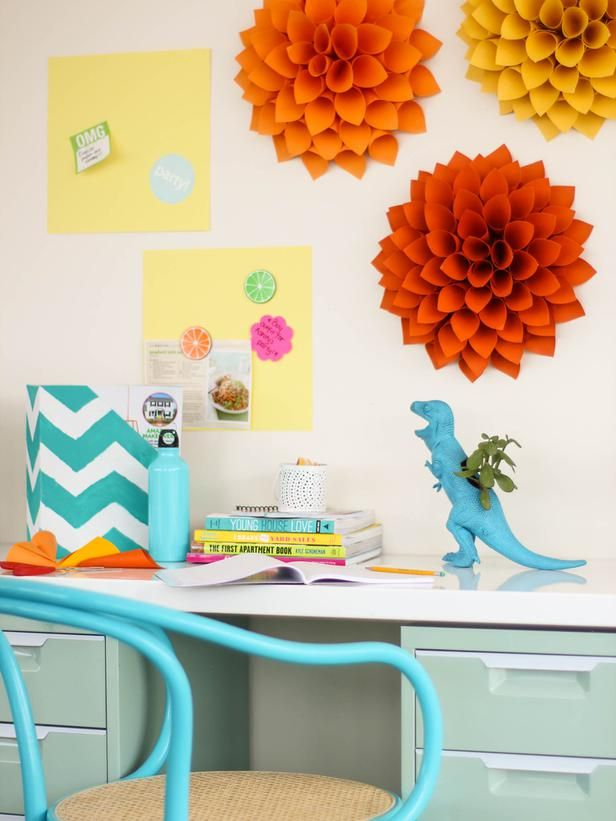 Dress up blank walls with oversized paper dahlias in a variety of hues using scrapbook paper or leftover wrapping paper.