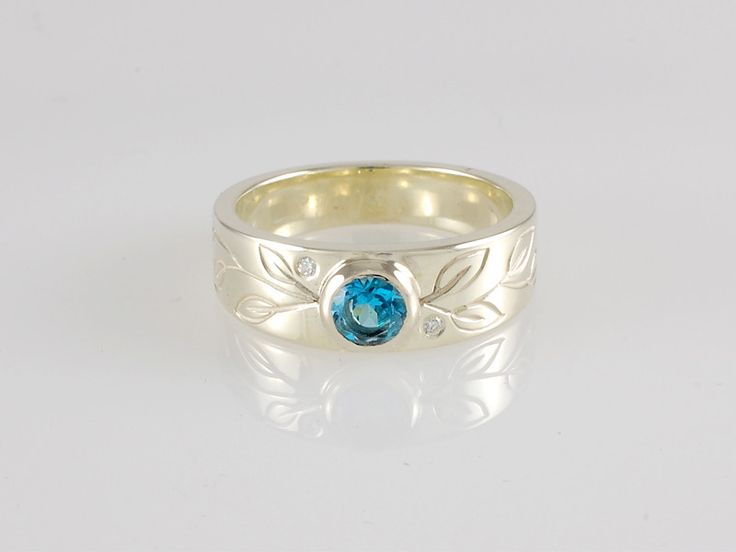 -CM600r- This is one of opur most admired rings. The crisp icy cold colour of the Swiss Blue Topaz is just stunning. WE have also made this with yellow Citrine but the Blue Topaz is by far the most popular colour. This ring is sold. Let us create a special ring for you. Check out our website https://jewelbeetle.co.nz or our gallery on smugmug https://jewelbeetle.smugmug.com