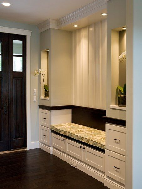 Beautiful foyer cabinetry. Great storage for all the miscellaneous and beautiful accent lighting. This space really speaks for itself!