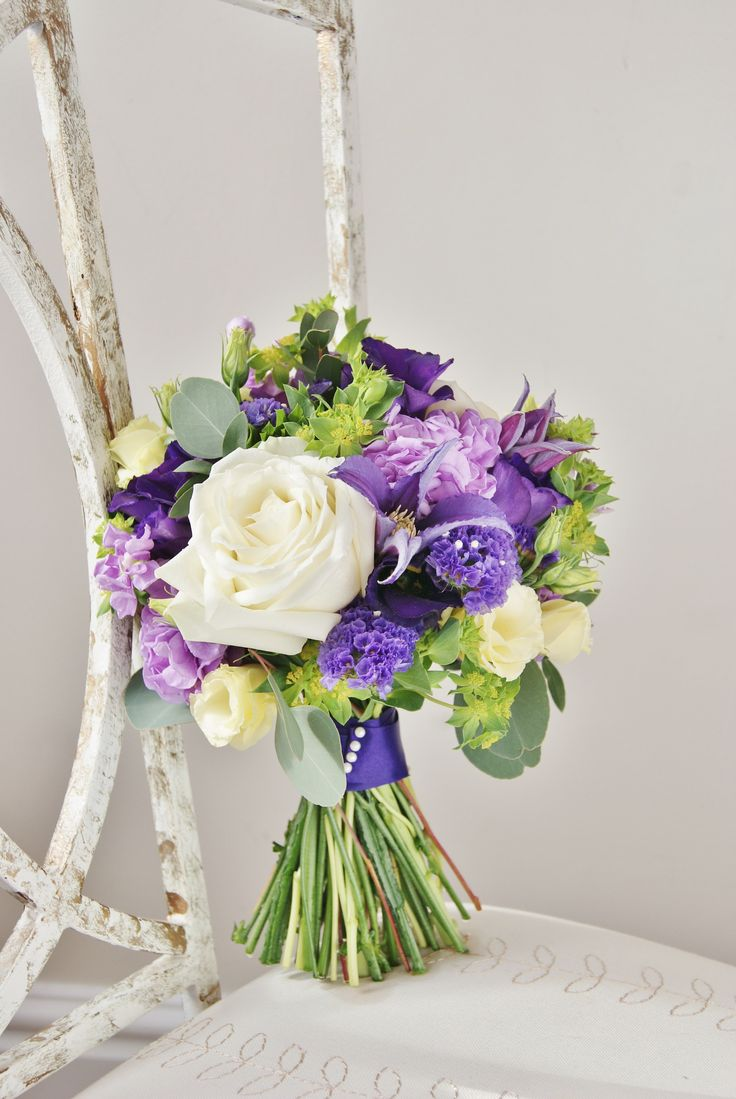 Florissimo, Shropshire - Flowers for weddings, events and businesses. Hand-tied bridal bouquet of white avalanche roses, purple lisianthus, white lisianthus, purple statice, purple stock, purple clematis, green bupleurum and eucalyptus.