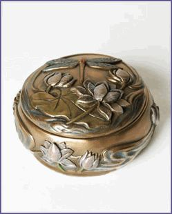 The Arts and Crafts Dragonfly Trinket Box is cast in cold cast resin with a brass patina finish and color inlays. The perfect size for small trinkets or jewelry.