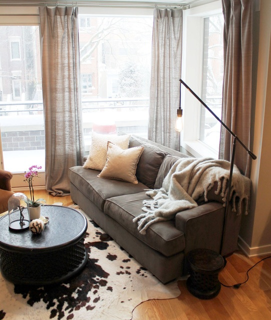 cozy. love the chunky blanket.: House Tours, Coffee Tables, Living Rooms, Industrial Lamps, Brown Cows Rugs, Luxury Houses, Cowhide Rugs, Floors Lamps, Houses Tours