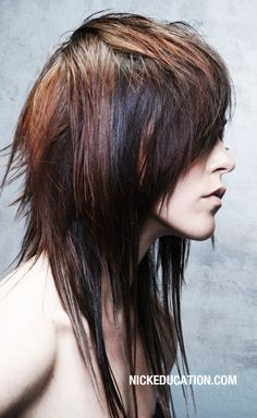 Dark long layered shag haircut with panels of red hair coloring