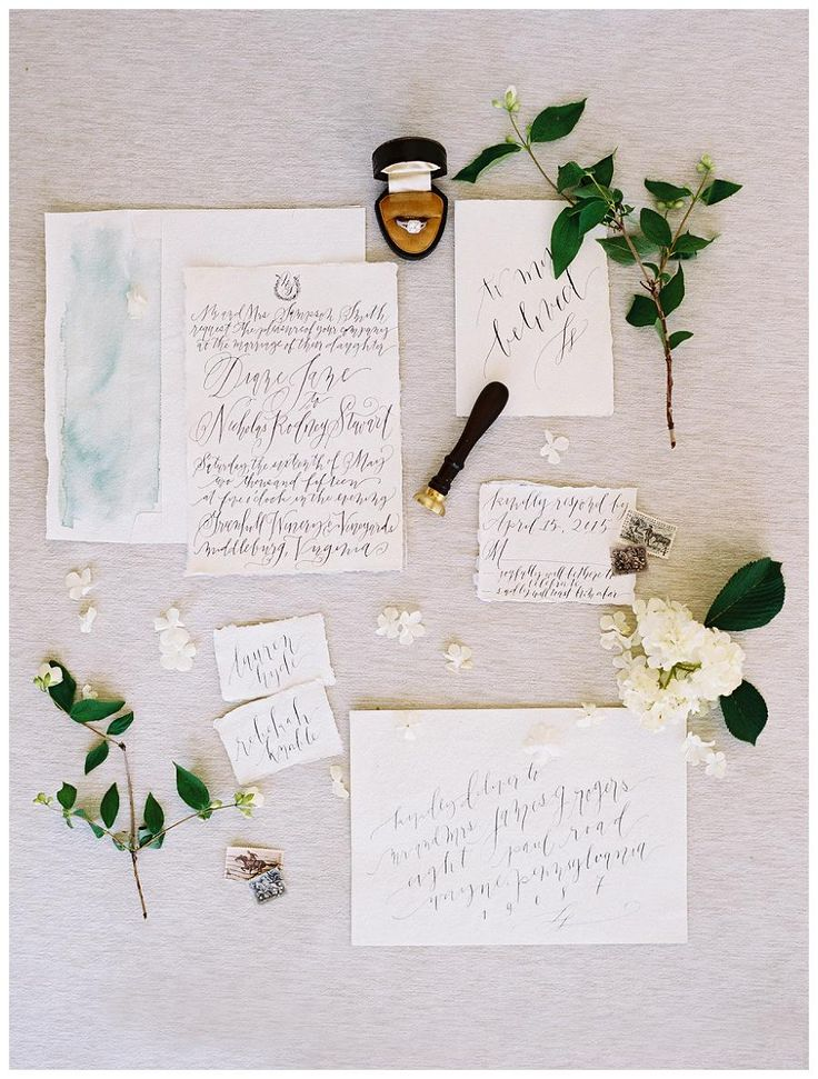 Exquisite wedding invitation suite on deckle edge paper with graceful calligraphy by Laura Hooper Calligraphy. Image by Abby Jiu.