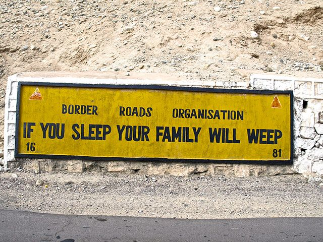 India road signs: If you sleep your family will weep