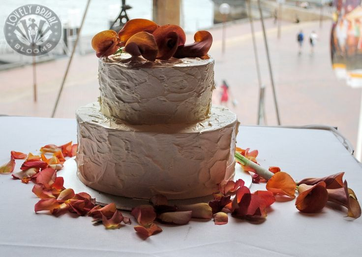 Orange Calla Lilies intertwined on top of cake