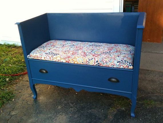 2nd grade reading bench, will have 1 book shelf of each side. Painted pale grey with zigzag grey/white fabric seat and back cushion. Kids write and illustrate their own book (printed hardbound) and stored in shelf.