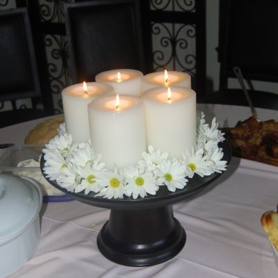 Cake Stand centrepiece - perch a cluster of different sized candles; use it to display pretty soaps of perfume bottles