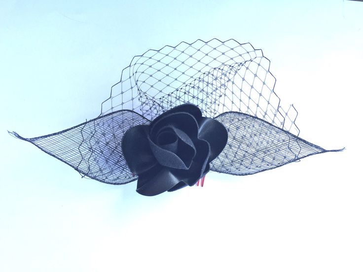 A personal favourite from my Etsy shop https://www.etsy.com/au/listing/250631355/black-leather-flower-fascinator-with