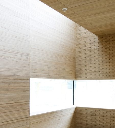 Plexwood wellness design, calm waiting room with plywood birch wall and ceiling panels // NSW Arkitekter / Ratio Arkitekter