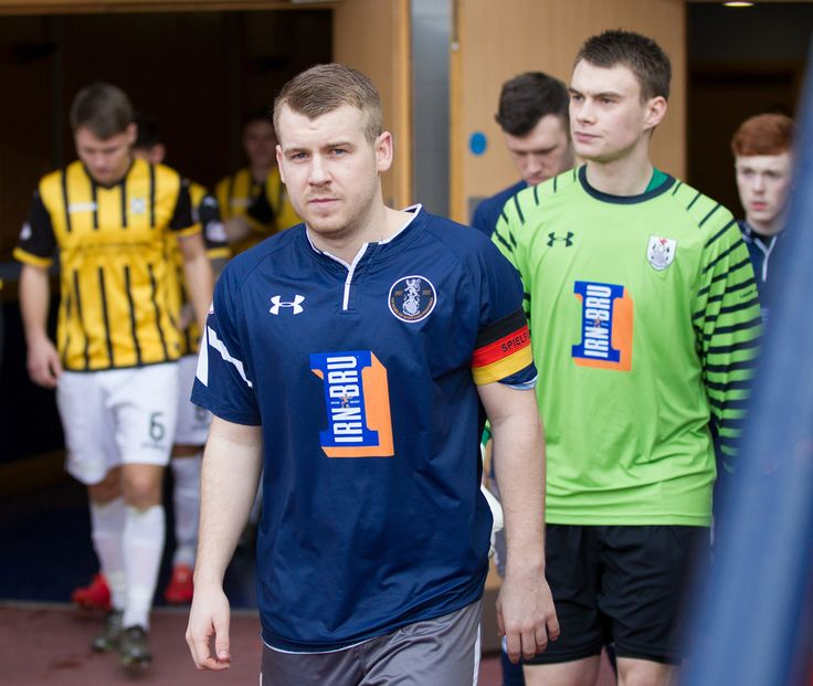 Queen's Park's Jamie McKernon leads his team out before the Ladbrokes League One game between Queen's Park and East Fife.