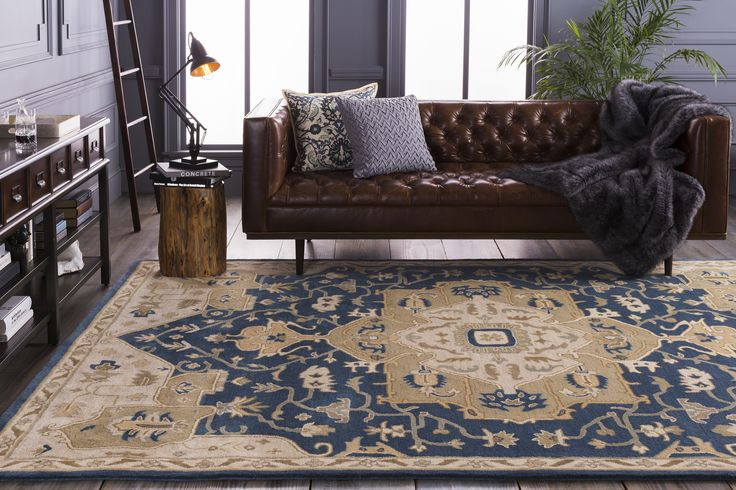 A traditional rug paired with a leather couch to encompassing a new look in a living room.