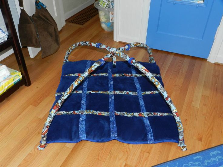 Play mat for Stevie with doubled fuzzy fabric. Irrigation tubing is covered with fabric and attached with velcro.