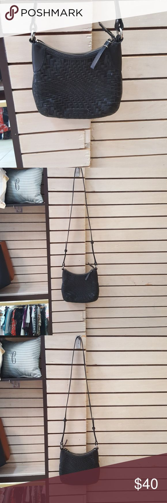 New Cole Haan Purse Cute leather crossbody purse, this was a display model in our retail store, never owned but no tags attached, great compartments inside with key chain attachment, GREAT DEAL!!! Cole Haan Bags Crossbody Bags