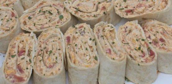 Ingredients    8 oz. cream cheese, softened  1-2 Tablespoons Spicy Ranch Dressing  10 oz can Rotel Mexican Lime & Cilantro dice tomatoes, drained  1/4 -1/2 cup red onions, diced  2 chicken breast, seasoned, cooked & shredded  1 cup colby jack cheese or mexican blend cheese, shredded  2 cloves ga