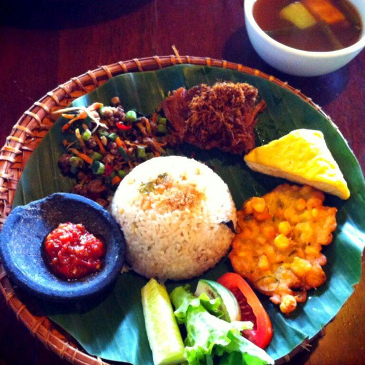 Traditional food of jakarta Nasi uduk, sambel terasi, bakwan jagung, sayur asem, lalap, oncom , yummy