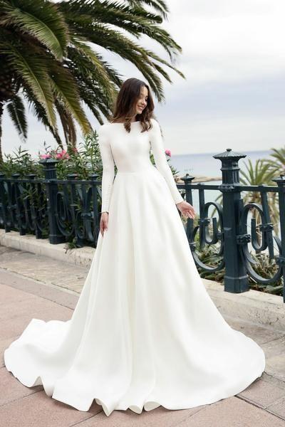 Boat neck long sleeved ivory satin wedding dress