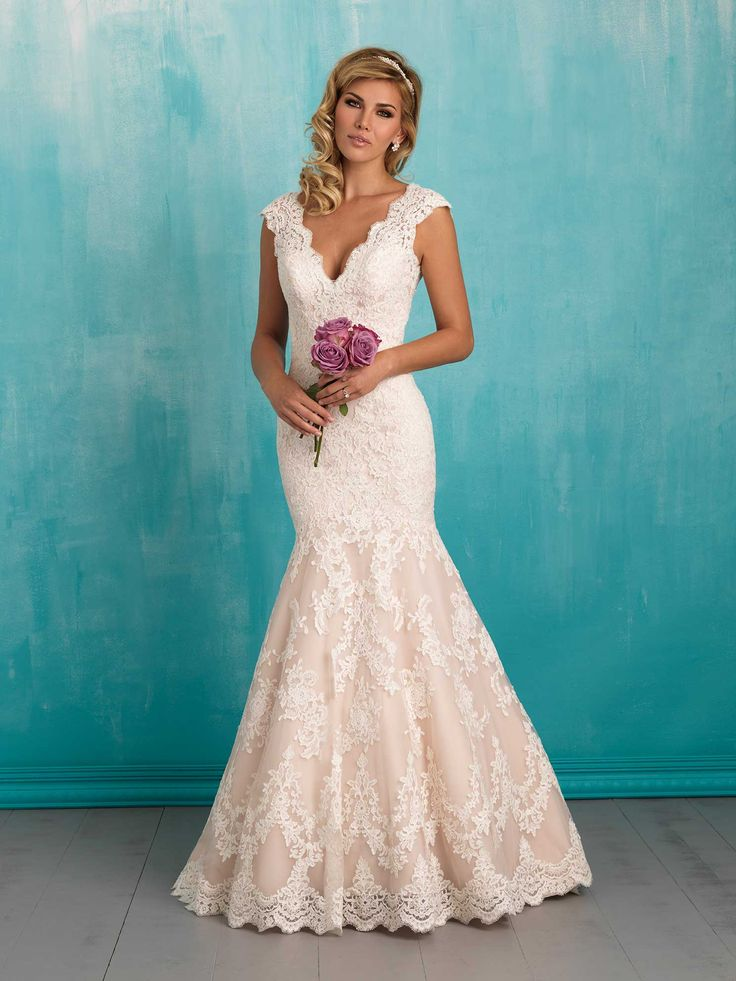 Style: 9320 Classic lace composes this simple yet striking gown. Color: White, Ivory, Champagne/Ivory Fabric: English Net
