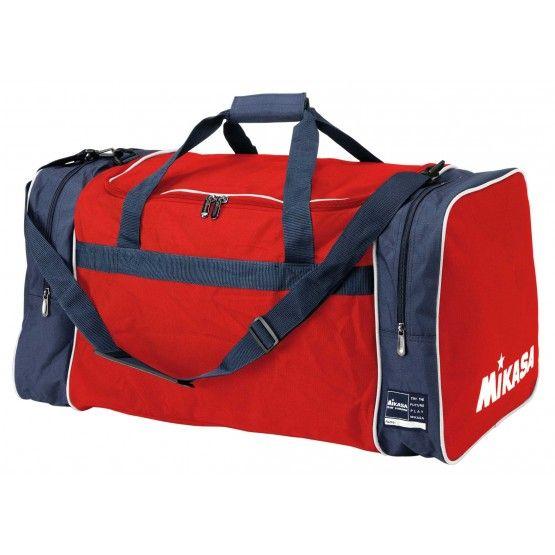 Mikasa Taka nagy utazó táska piros,kék színben professzionális csapatfelszerelés versenyekre, nagyobb utazásokra ideális sporttáska. Elegendő hely a sportruházat és sportcipők elhelyezésére. Két oldalsó zsebbel és kétirányba nyitható cipzárral. Belül cipzáras védett zseb. Állítható pánt. Külső zseb a vizes vagy használt ruházat elhelyezésére illetve tisztálkodási eszközöknek. Kiváló minőségű 100 % poliészter. Mérete: 70 x 36 x 34 cm.  Rendelésre. Szállítási idő 7 - 10 munkanap.