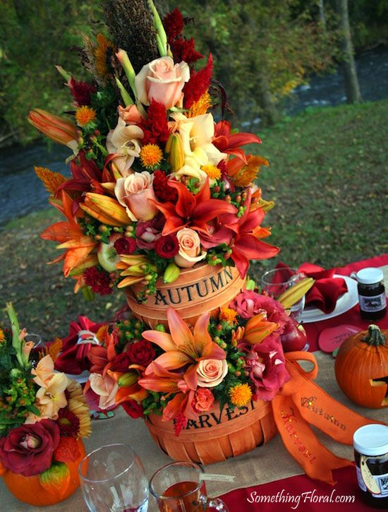 Multi Tier Autumn Harvest Centerpieces Containing A Variety Of Color Flowers Designed By Fall Wedding