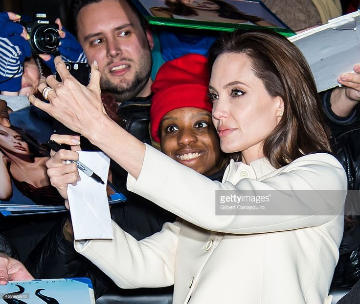 Angelina Jolie taking a selfie with a fan outside The Daily Show with Jon Stewart (Photo by Gilbert Carrasquillo) | #selfie #NYC