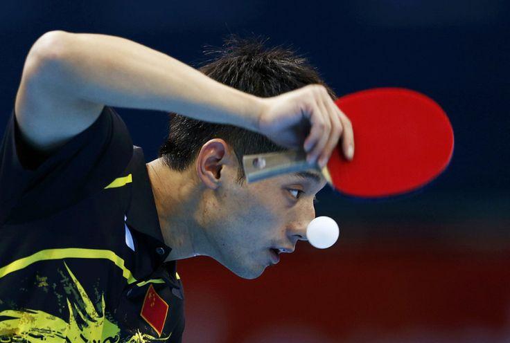 China's Zhang Jike serves to Belarus' Vladimir Samsonov in their men's singles fourth round table tennis match.