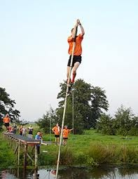 """Polstokspringen. Fierljeppen (lit. far-leaping) is a traditional sport of the Frisians and of the Dutch. Ljeppen is West Frisian for """"to leap"""". It is a fine example of the close relationship between the Frisian and English languages."""