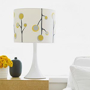 Print out our stylized branch and blossom templates to give a plain lamp shade a fun #makeover: www.familycircle.... #DIY #craft