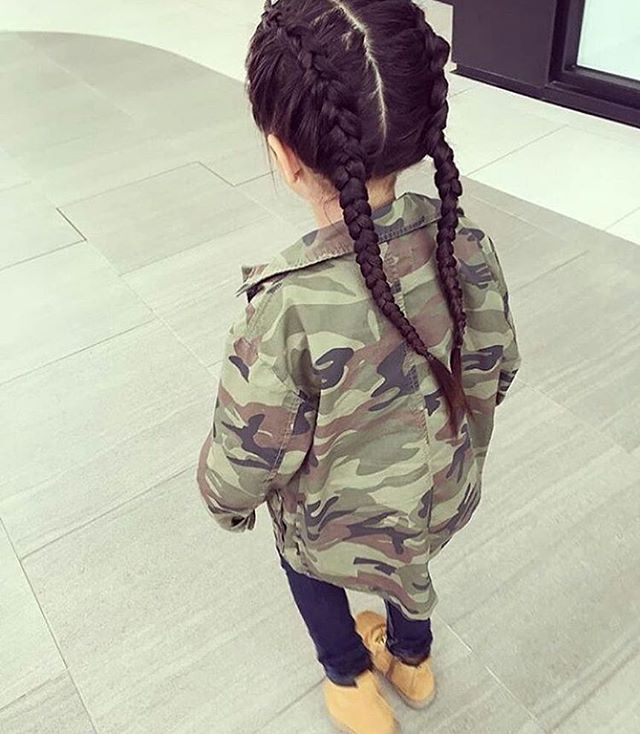 Toddler girl style. Camouflage jacket, skinny jeans and two French braids
