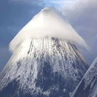 Cone cloud over mountain in Russia.