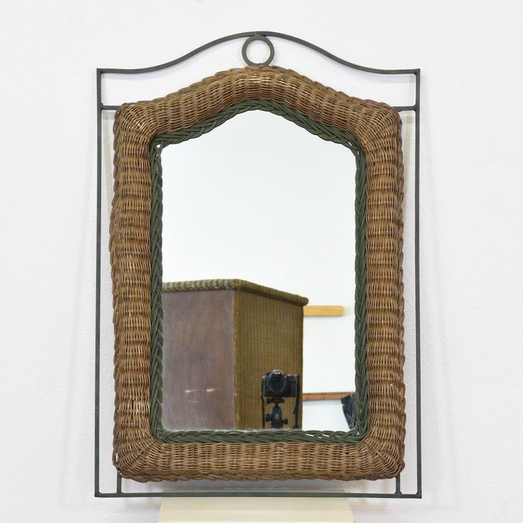 This mirror is featured in a woven wicker rattan with a dark wood finish. This wall mirror is in great condition with a curved top and metal iron sides with a black finish. Simple mirror perfect for a vanity or dresser! #tropical #decor #mirror #sandiegovintage #vintagefurniture