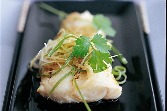 Ken Hom's steamed fish Cantonese style. Recipe at http://www.lovefood.com/guide/recipes/26676/ken-homs-steamed-fish-cantonese-style-recipe