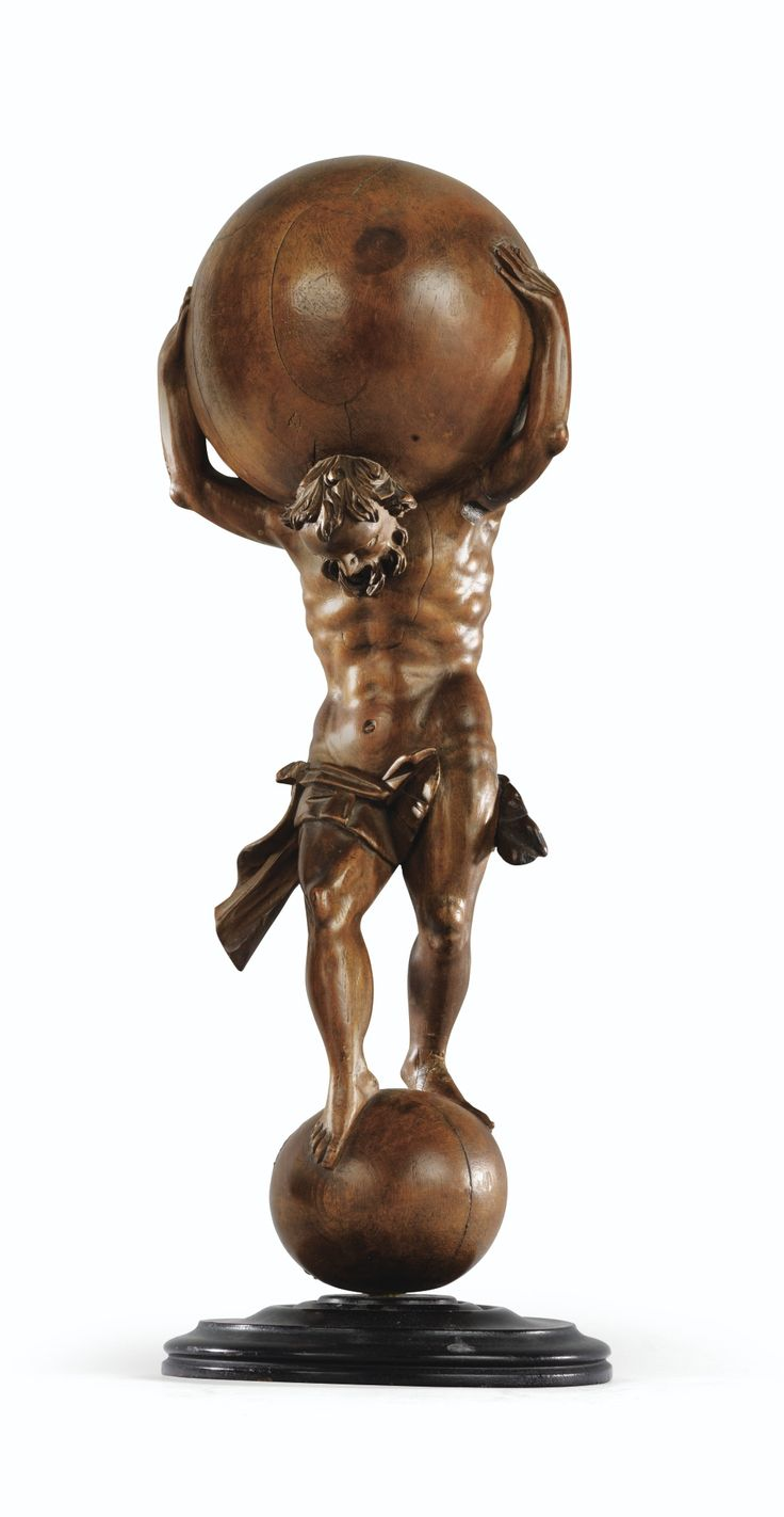 A GERMAN 18TH CENTURY FRUITWOOD STATUETTE OF ATLAS CARRYING THE GLOBE. H: 42 cm; 16 1/2 in. -Sotheby's-