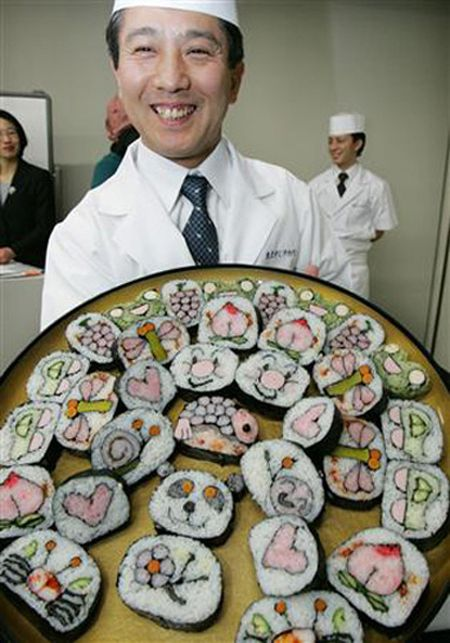 Chef behind sushi art - fun food