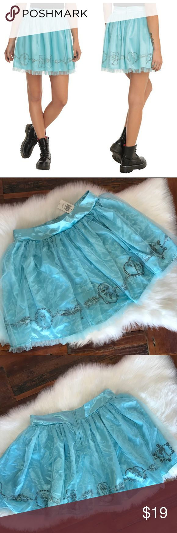 NEW Frozen Disney Hot Topic Skirt Halloween Winter Brand new with tags, has been stored folded up so it could use a fresh steam. Tulle overlay. Frozen Elsa border on the bottom with quotes in between. Shines aqua blue. Tulle ruffle on bottom. Wear this skirt for Halloween and all throughout winter! Adorable with black sweater and black tights. Disneyland or Disney World ready! Zips up the back. Waist laid flat is 16 1/4 in. Length is 19. Bundle for a 20% discount. Costume. Disney Skirts Mini