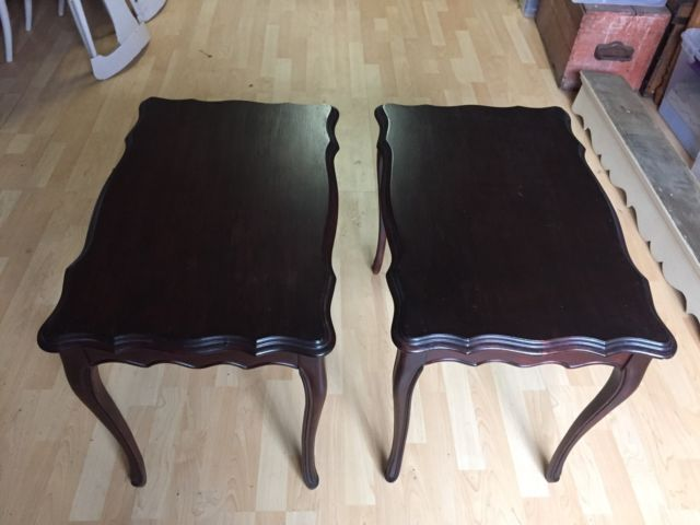 Pair of solid wood, French Provincial side tables with a dark cherry stain finish. The tables are good quality and in great   dimensions 18w x 28l x 22h  $80