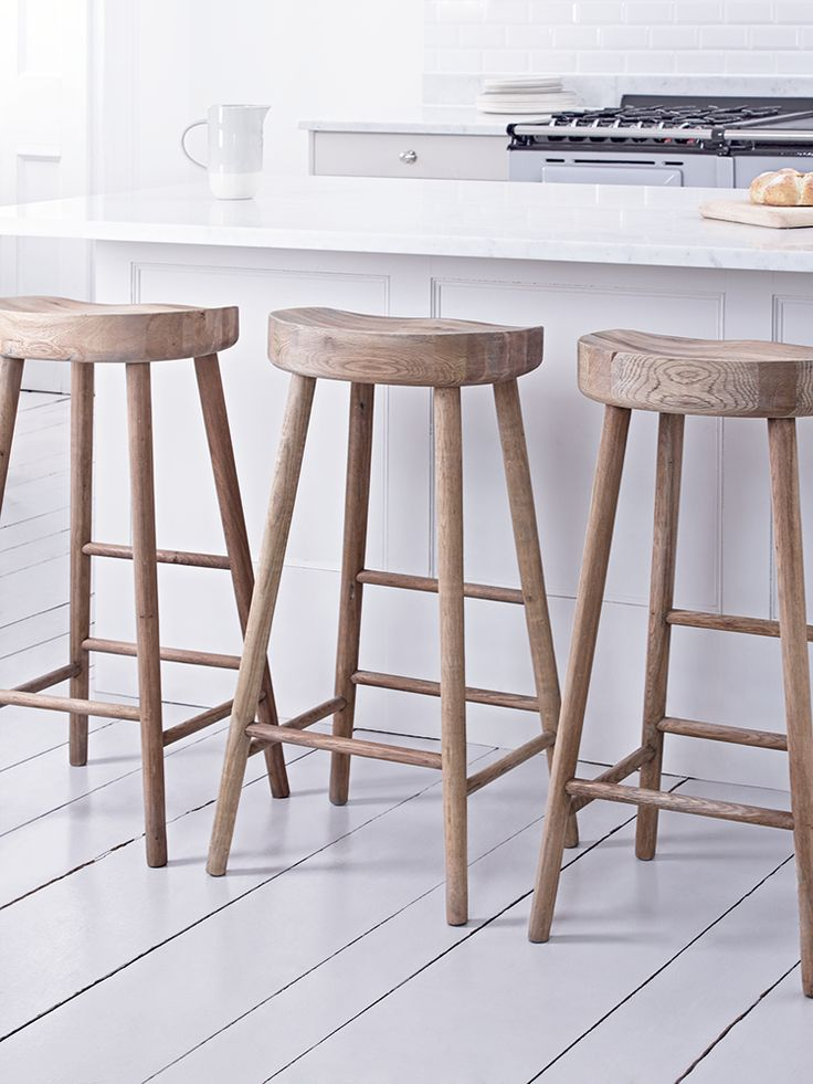 Our simple, elegant stool is beautifully crafted from weathered oak with a carved seat for comfort. With a rung to rest your feet, our robust farmhouse stool is the perfect height for a breakfast bar and complements a country rustic look.