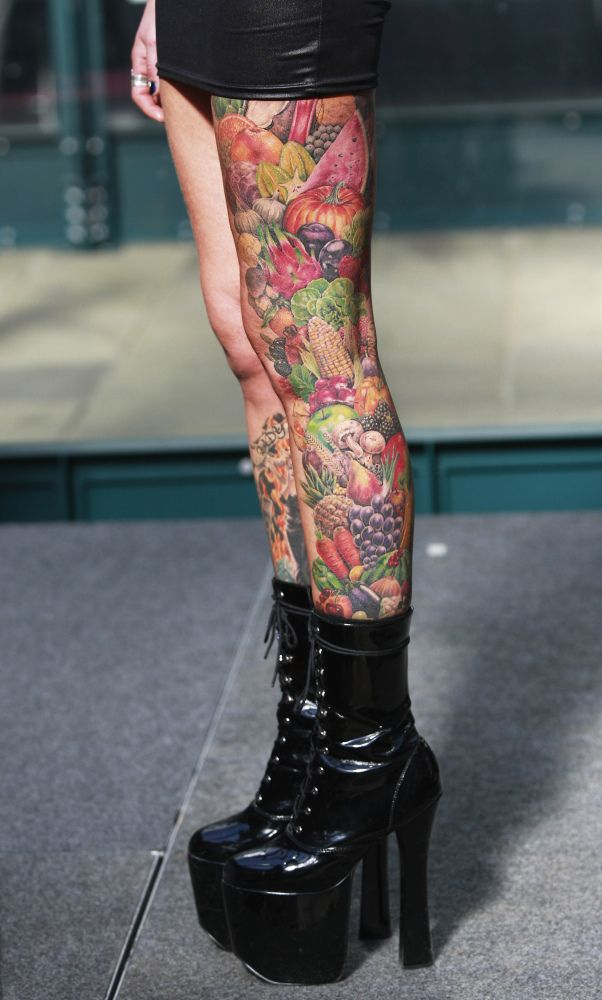 A woman shows off her tattoos at the International London Tattoo Convention, in east London, Friday, Sept. 25, 2009.
