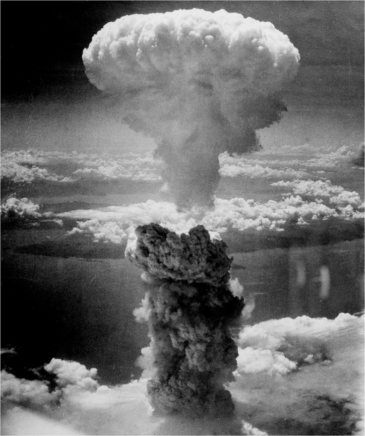 Smoke mushrooms thousands of feet into the air above Nagasaki, August 9, 1945, after U.S. dropped its second atomic bomb on Japan. A B-29 airplane delivered the bomb, which killed approximately 70,000 people. The attack came three days after the first atomic bomb was dropped on Hiroshima. // margaret bourke white.