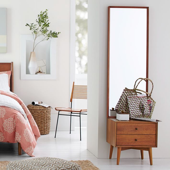 Reflect on this. Full length and freestanding, the Mid-Century Storage Mirror yields a full-body view, with two drawers for hiding odds and ends. It's crafted from FSC®-certified wood, adding modern-day sustainability to its timeless style.