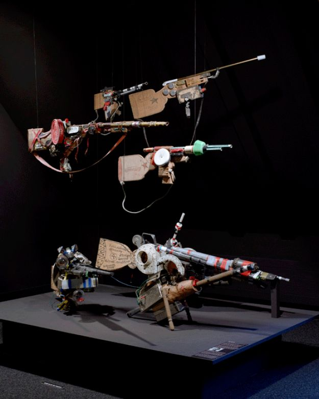ANDRé ROBILLARD (1932) | FUSILS | He stored the guns, spaceships and sputniks that he has made since 1964 from objects he salvaged from the rubbish tip, such as food tins, old lightbulbs, pieces of wood, plastic piping and metal bars. He assembled these diverse elements with adhesive tape and iron wire. In 1989, he moved into an apartment where he continues his production without any discontinuity. Collection de l'Art Brut, Lausanne, Switzerland